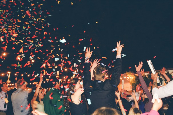 Multi-color wedding confetti cannons used on the dance floor