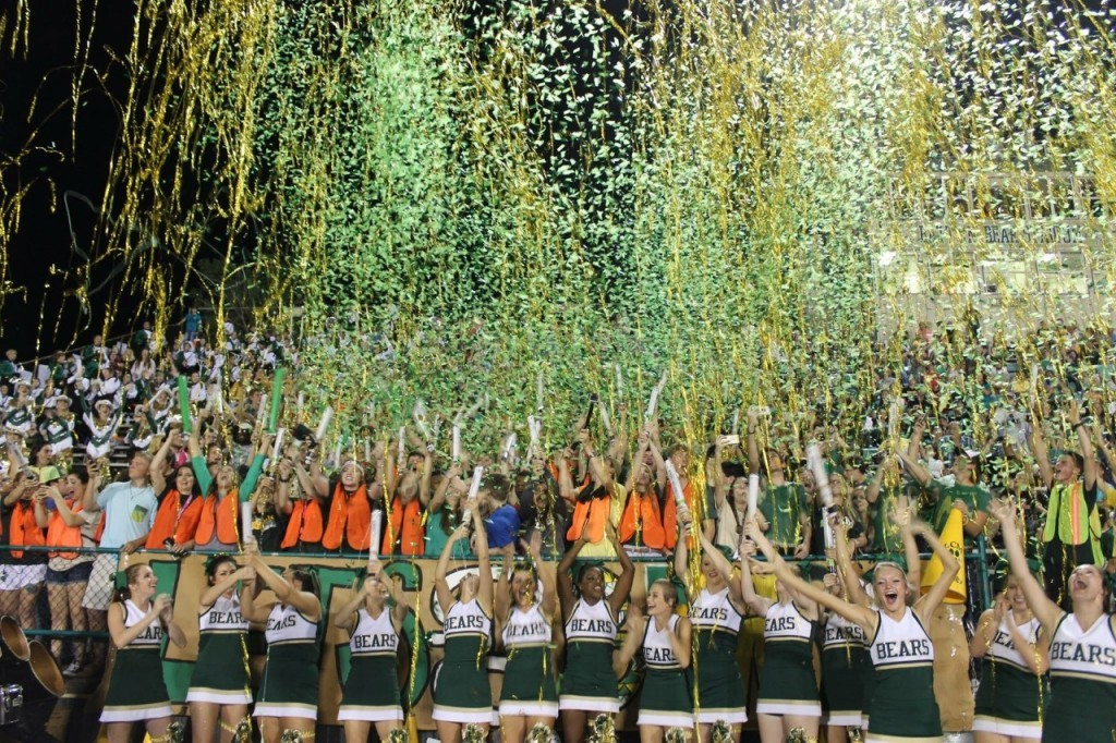 Homecoming at Little Cypress Mauriceville High School in Orange, TX with Green Confetti Cannons and Gold Metallic Streamer Cannons